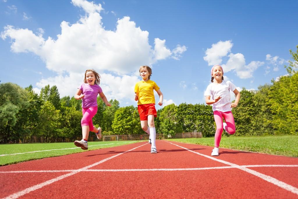 Smiling children running marathon together